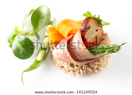 anchovies on white with spice and vegetables - stock photo