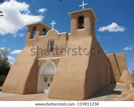 Ancient adobe house in Taos Pueblo, New Mexico - stock photo