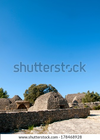 Ancient agricultural outhouses made of dry stones in The Bories Village (Village des bories) near Gordes, Provence in France - stock photo