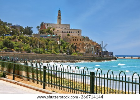 Ancient and modern port of Jaffa in Israel. The seafront fenced openwork low fence - stock photo