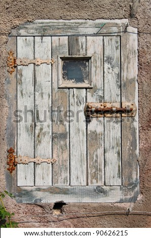 Ancient and weathered  wood front door of a castle