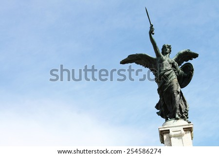 Ancient Angel Statue in the Italian Capital city of Rome. - stock photo