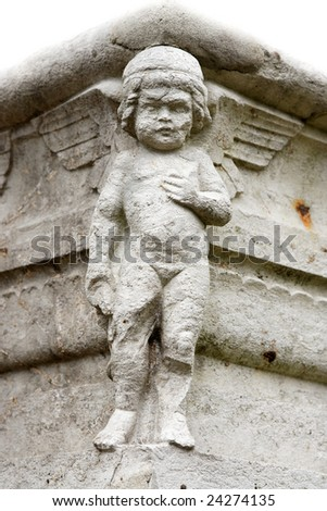 Ancient angle sculpture at a gravestone in a grave yard - stock photo
