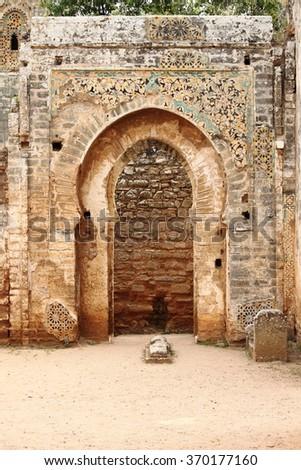 Ancient arabic door in the Necropolis of Cellah in Rabat, Morocco - stock photo
