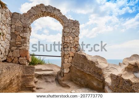 Ancient arch in fortress on Kaliakra headland, Bulgarian Black Sea Coast - stock photo