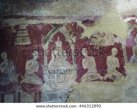 Ancient art about buddha story on temple wal - stock photo