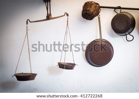 ancient balance hanging on the old wall in Sicily - stock photo
