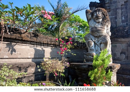 Ancient balinese statue. A part of the Tanah Lot temple gate. - stock photo