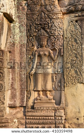 Ancient bas-reliefs on the wall of a temple, Angkor Wat, Cambodia