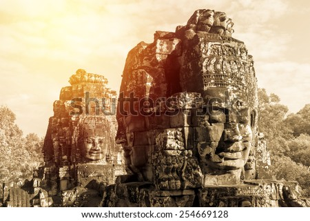 Ancient Bayon castle, Angkor Thom, Cambodia. Vintage filter. - stock photo