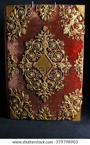 Ancient book decorated with velvet and gold accents