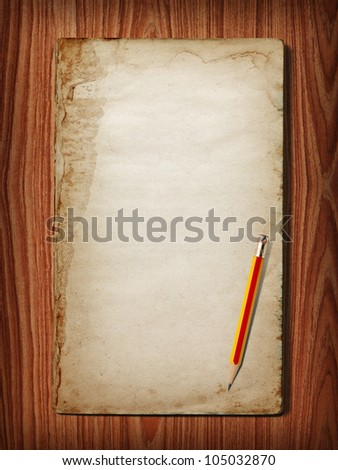 Ancient book on wood background. drop your text on the space - stock photo
