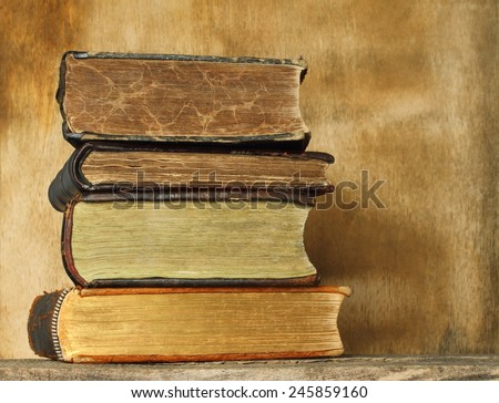Ancient books on wooden background  - stock photo