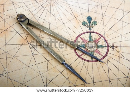 Ancient brass dividers on a nautical chart - stock photo