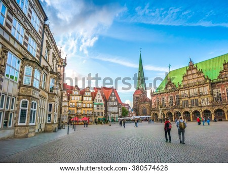 Ancient Bremen Market Square in the centre of the Hanseatic City of Bremen with view on famous Raths-Buildings, Church of Our Lady (Unser Lieben Frauen Kirche) and town hall, Germany - stock photo