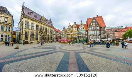 Ancient Bremen Market Square in the centre of the Hanseatic City of Bremen with view on The Schuetting (former guild house) and famous Raths-Buildings, Germany - stock photo