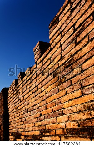 ancient brick fortress wall on blue sky