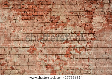 Ancient brick wall as a background - stock photo