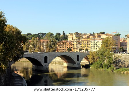 Ancient bridge above the river Tiber  in Rome, Italy