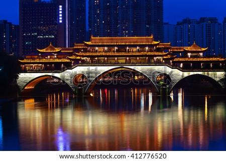 Ancient bridge building of Night in Chengdu China - stock photo