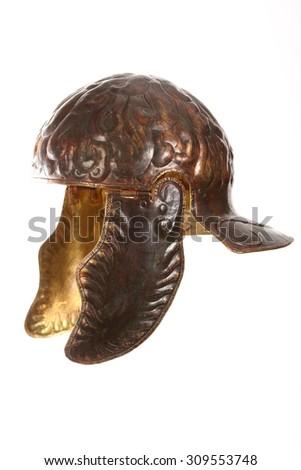 ancient bronze roman helmet over white - stock photo