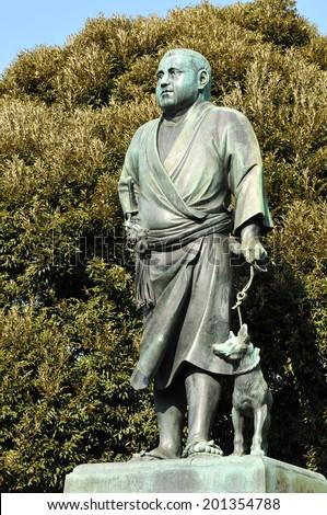 Ancient bronze statue of samurai in Tokyo, Japan - stock photo