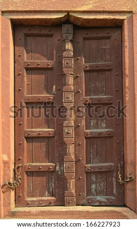 Ancient Brown wooden door at Taj Mahal