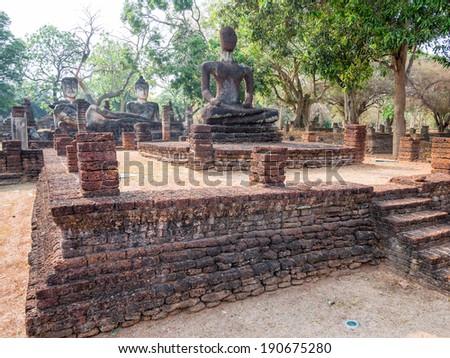 Ancient Buddha at Kamphaengphet Historical Park, Thailand - stock photo