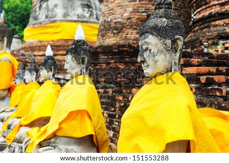 Ancient Buddha in a row - stock photo