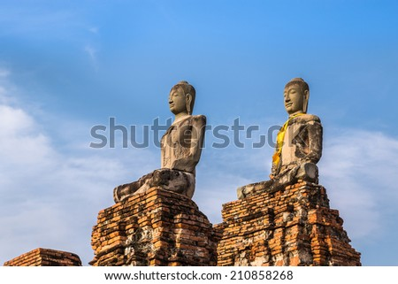 ancient buddha sandstone statues on blue sky background