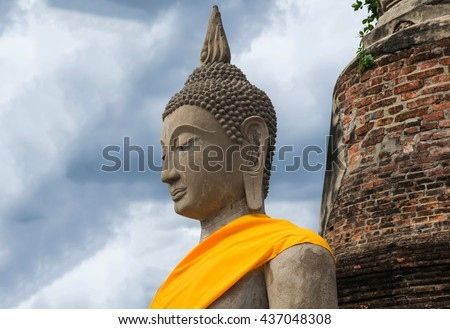 Ancient buddha statue with old pagoda of thailand - stock photo