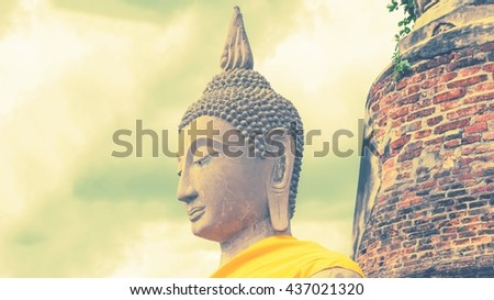Ancient buddha statue with old pagoda soft style - stock photo