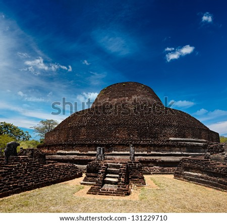 Ancient Buddhist dagoba (stupe) Pabula Vihara. Ancient city of Pollonaruwa, Sri Lanka - stock photo