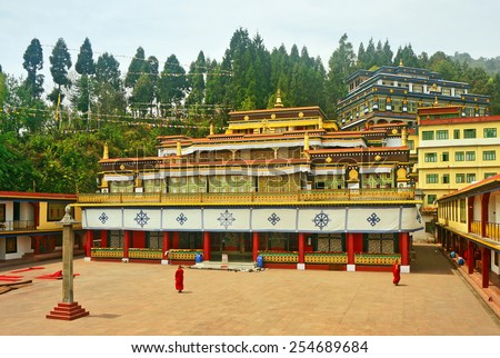 Ancient Buddhist Monastery and Monks - stock photo