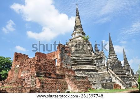 Ancient Buddhist pagoda ruins at Wat Phra Sri Sanphet temple, Ayutthaya, Thailand . - stock photo