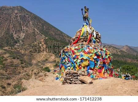 Ancient Buddhist stupa near Wusutu Zhao temple in Daqing Mountain, Inner Mongolia, China - stock photo