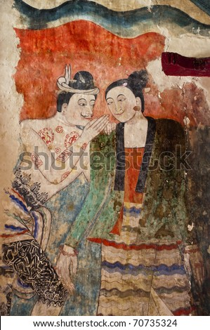 Ancient Buddhist temple mural depicting a Thai daily life scene at Wat Phumin, a famous temple in Nan province, Thailand. The temple is open to the public and has beautiful murals on the walls. - stock photo