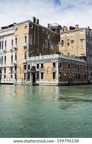 Ancient buildings in Venice. Boats moored in the channel. View from the side of the water