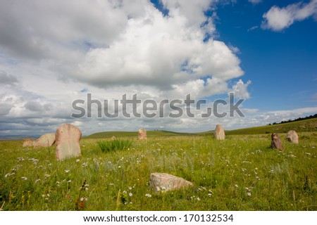 Ancient burial mound in the steppe of Khakassia - stock photo