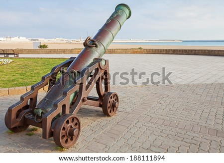 Ancient cannon stands on the beach in Tangier, Morocco - stock photo