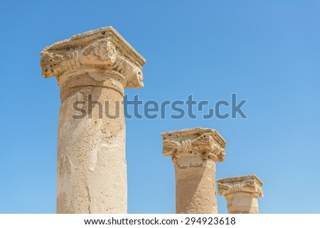 Ancient carved stone columns at an archaeological site in Paphos, Cyprus. - stock photo