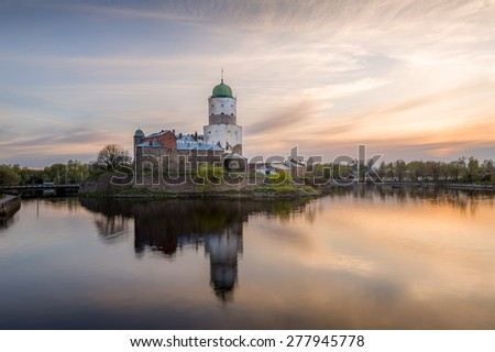 Ancient castle at small island, sunset landscape at calm weather. Russia. - stock photo