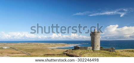ancient castle by the sea in county clare ireland - stock photo