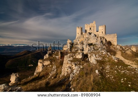 Ancient castle of Calascio at sunrise with snowed mountains in background