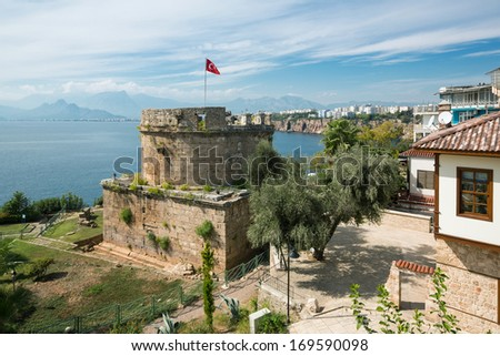 Ancient Castle Tower in old town Kaleici, Antalya. View on anatolianan bay, sea and Antalya city.    - stock photo