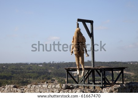 Ancient castle with a dead hangmen - stock photo