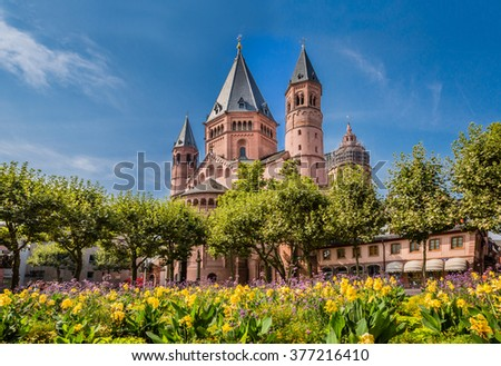 Ancient cathedral in Meinz, Germany surrounded by spring flowers  - stock photo