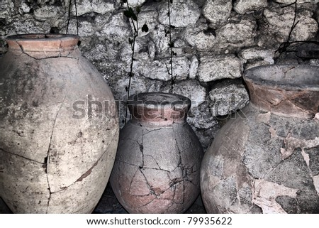 ancient ceramic pitchers at the wall