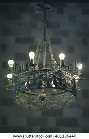 ancient chandelier on the ceiling of old castle - stock photo