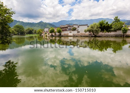 Ancient Chinese village of Hongcun and reflection, a unesco world heritage site in China - stock photo